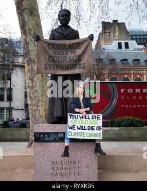 London, UK. 15th Mar, 2019. Young girl with banner strike for climate change outside Westminster. Credit: AndKa/Alamy Live News - Stock Photo