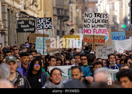 Turin, Italy. 15th March, 2019. Campaigners for action on climate change protest with home-made placards in city centre as part of Fridays for Future climate strikes. Credit: MLBARIONA/Alamy Live News - Stock Photo