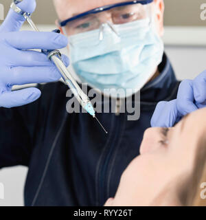 Patient receiving dental anaesthetic. - Stock Photo
