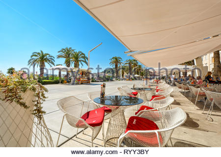 Afternoon view from waterfront sidewalk cafe at the Riva Promenade at the port of Split Croatia on the Dalmatian Coast of the Adriatic Sea - Stock Photo