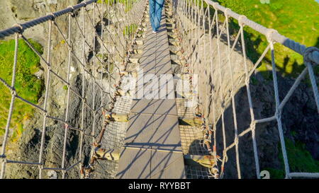 The footbridge in the Carrick-a-Rede in the National Trust Northern Ireland - Stock Photo