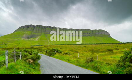 The large rock formation called the Benbulbin. Benbulbin sometimes spelled Ben Bulben or Benbulben is a large rock formation in County Sligo Ireland. - Stock Photo