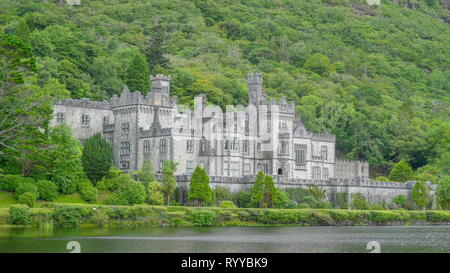 The beautiful Kylemore Abbey Monastery. Kylemore Abbey is a Benedictine monastery founded in 1920 on the grounds of Kylemore Castle in Connemara Count - Stock Photo