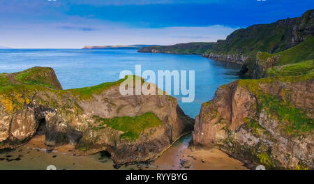 The big rocks of the cliff in Carrick-a-Rede. Carrick-a-Rede Rope Bridge is a famous rope bridge near Ballintoy in County Antrim Northern Ireland. - Stock Photo
