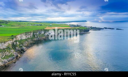 Aerial landscape view of the sea and the cliff in Carrick-a-Rede Rope Bridge tourist destination in North Ireland in Ireland - Stock Photo