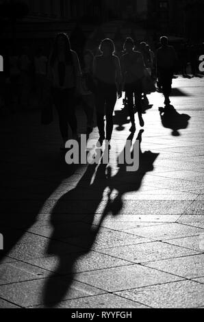 Walking people in the city, silhouettes, black and white street photography - Stock Photo