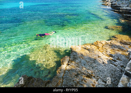 Scenic view of Emplisi Beach, picturesque stony beach in a secluded bay, with clear waters popular for snorkelling. Small pebble beach near Fiscardo t - Stock Photo