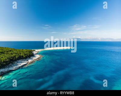Aerial view of Emplisi Beach, picturesque stony beach in a secluded bay, with clear waters popular for snorkelling. Small pebble beach near Fiscardo t - Stock Photo
