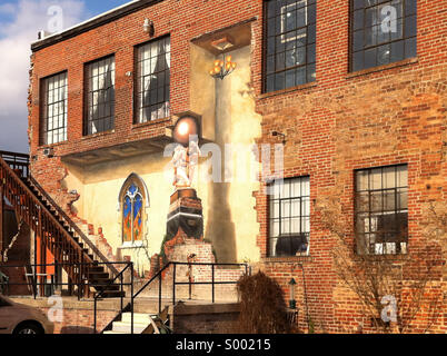 Trompe l'oeil (fool the eye) wall painting on a building in the River Arts District of Asheville, North Carolina. - Stock Photo