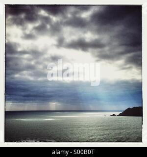 Dramatic light from Devon cliff top - Stock Photo
