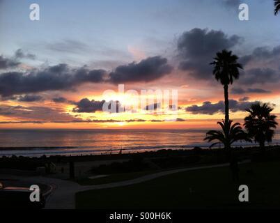 Sunset over beach - Stock Photo