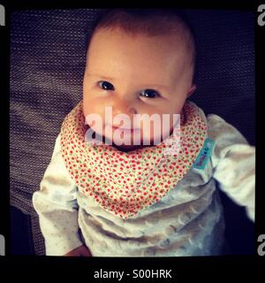 Baby girl aged 12 weeks - Stock Photo