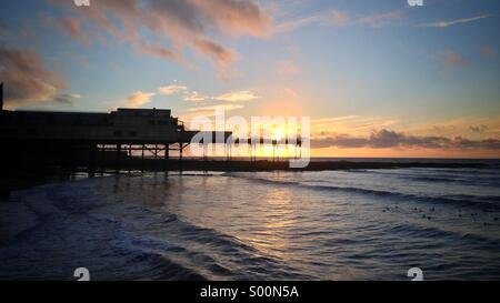 Sunset over Aberystwyth pier west Wales UK - Stock Photo