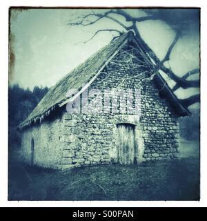Small stone chapel at Le Mas Saint-Jean on a winter day, Saint-Sulpice-le-Dunois, La Creuse, France - Stock Photo