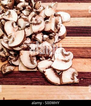 Sliced mushrooms on a cutting board. - Stock Photo