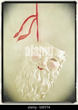 A ceramic santa claus decoration.