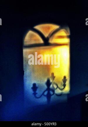 Shadow of a candelabra - Stock Photo