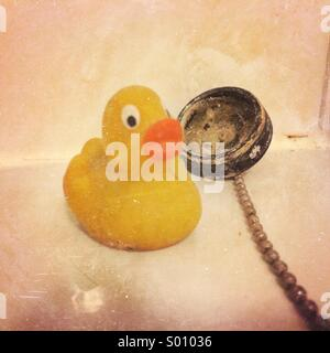 Yellow rubber duck and plug - Stock Photo