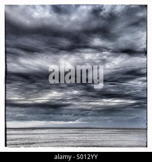 Storm clouds at sea - Stock Photo
