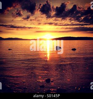 Sunset over Jura - Stock Photo