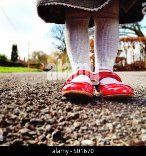 Girl in red shoes - Stock Photo