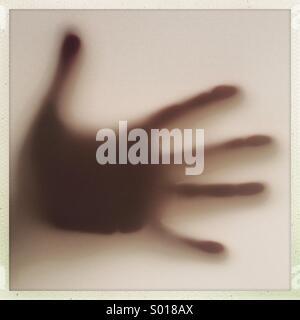 Hand silhoutte on window - Stock Photo