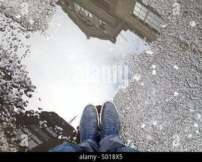 Standing at puddle in london - Stock Photo