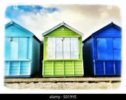 Colorful beach huts in highcliffe on sea,Dorset,uk. - Stock Photo