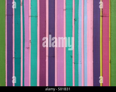 Multi colored pieces of wood on the side of a modern building. - Stock Photo