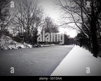 Frozen canal covered in snow - Stock Photo