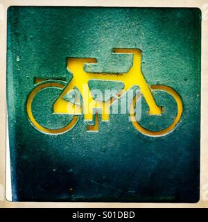 Bike sign on the wall - Stock Photo