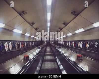 Central london tube station escalator empty late in the evening - Stock Photo