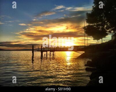 Sunset over a Swiss lake - Stock Photo