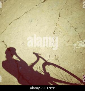 Bicycle riding in the sun - Stock Photo