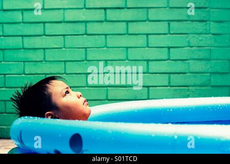 Kid in a kiddie pool - Stock Photo
