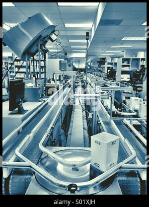 Automated Pharmacy  Prescription Assembly Line (fills 5,000 Rxs a day) - Stock Photo