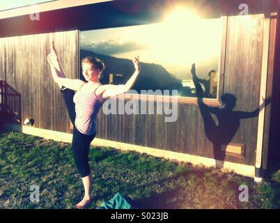 Woman doing yoga outside - Stock Photo