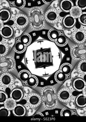 An abstract kaleidoscopic image created from a black and white image of an optometrist's examination equipment - Stock Photo