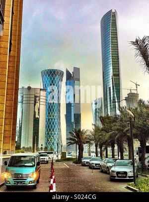Futuristic skyline of Doha, Qatar, from entrance to Marriott Renaissance and Courtyard hotels - Stock Photo