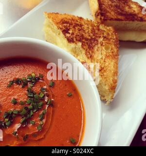 Grilled cheese and tomato soup - Stock Photo