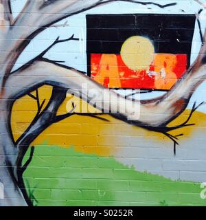 Street art featuring the Aboriginal flag in a tree, Lismore, NSW, Australia - Stock Photo