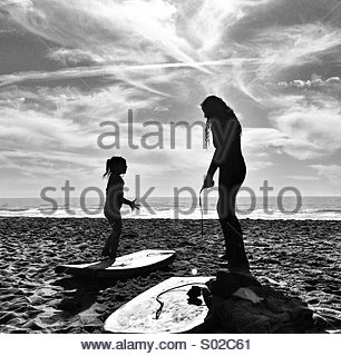 Two Girls On Beach Ready To Boogie Board - Stock Photo