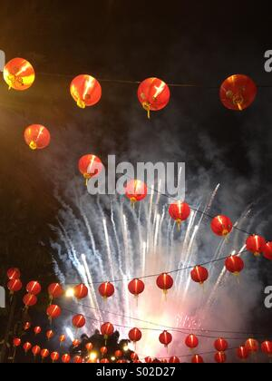 Chinese New Year lanterns fireworks - Stock Photo