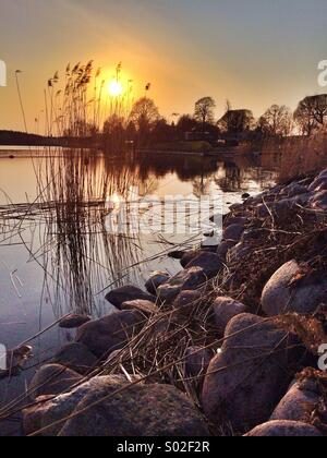 sunset in the stockolm archipelago - Stock Photo