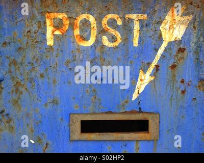 An old warehouse building in the dockland area of Liverpool advises where to post letters - Stock Photo