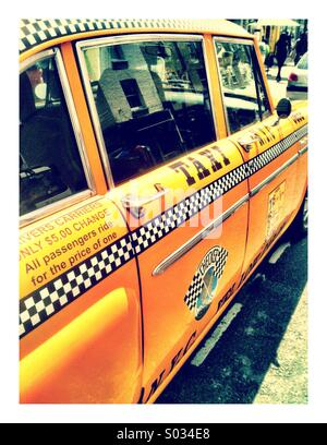 A New York yellow taxi cab. - Stock Photo
