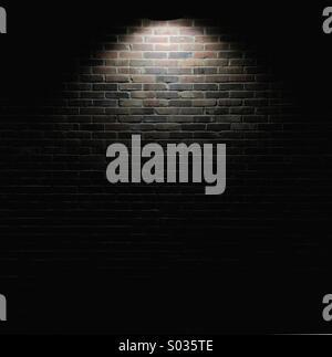 Spotlight From An Over Head Streetlight On A Brick Wall
