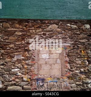 Bricked up window in an ancient wall in New Ross, Co. Wexford in Ireland. - Stock Photo