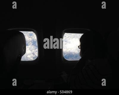 Looking out of a plane window. - Stock Photo