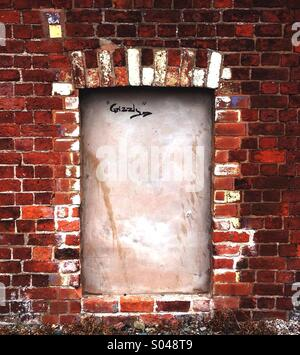Blocked in Window in Brick Wall - Stock Photo
